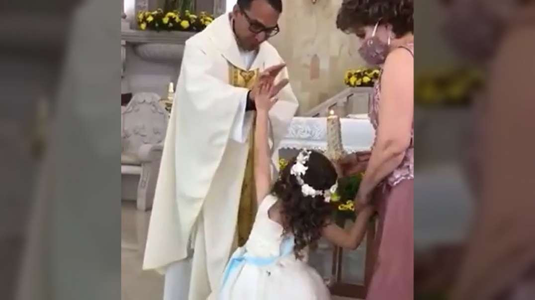 LITTLE GIRL GIVES PRIEST HIGH-FIVE